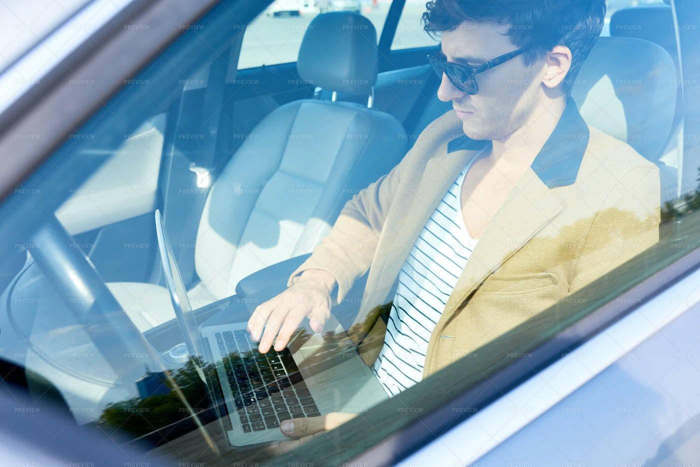 Young Entrepreneur Using Laptop In...: Stock Photos
