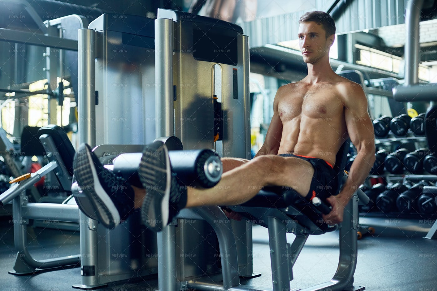 Exercising On Leg Extension Machine: Stock Photos