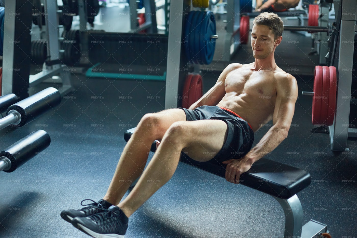 Muscular Man Exercising In Gym: Stock Photos