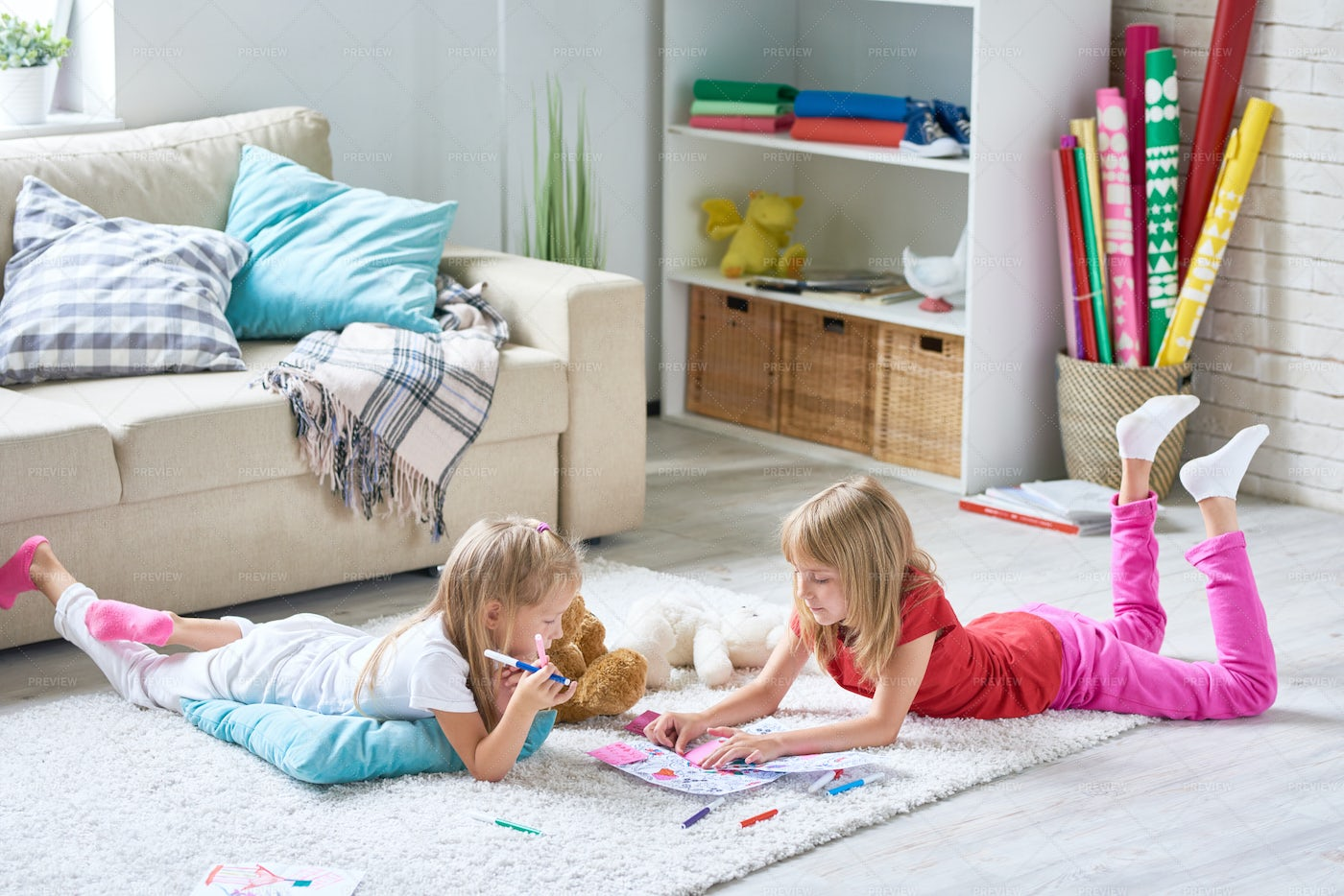 Girls Coloring Pictures On Floor: Stock Photos