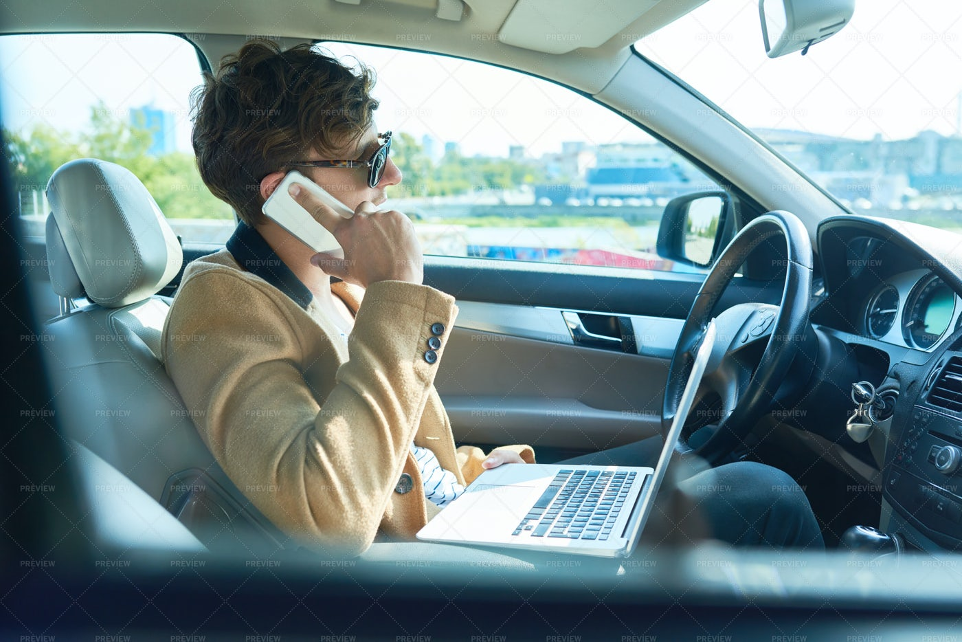 Rich Businessman Speaking By Phone...: Stock Photos