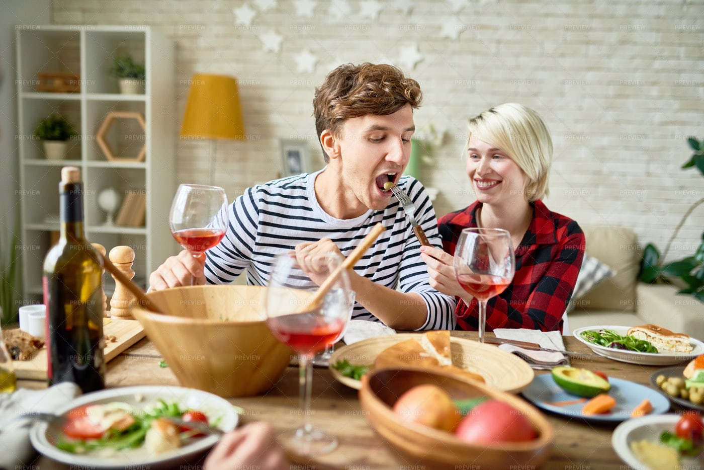 Happy Young Couple At Festive...: Stock Photos