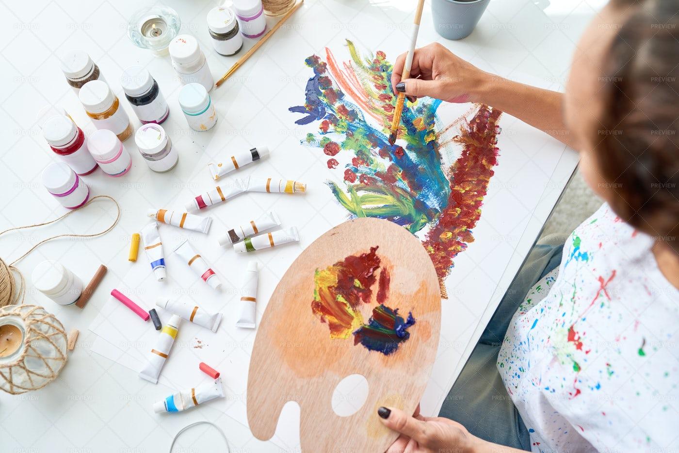 Artist Painting Flowers: Stock Photos