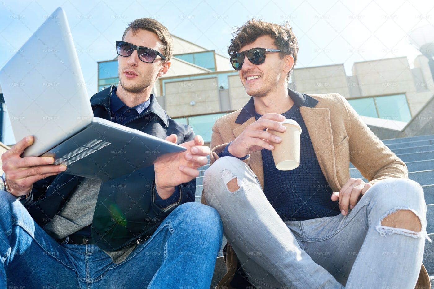 Modern Young Men Using Laptop In...: Stock Photos