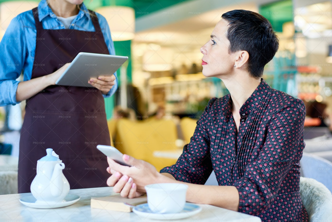 Elegant Woman Ordering Food In Cafe: Stock Photos