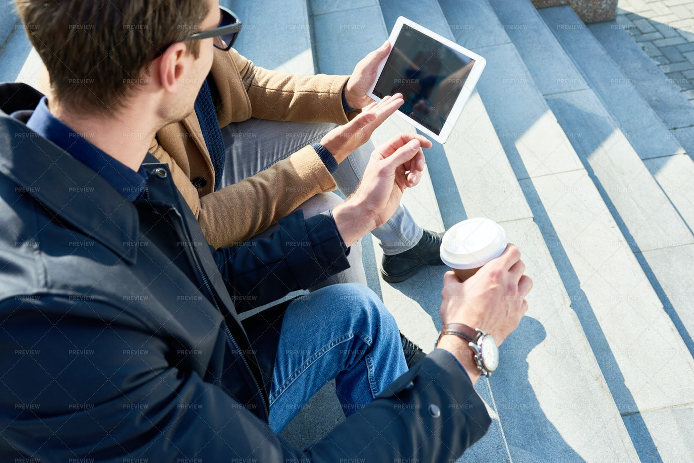 Two Young Men Using Tablet In City: Stock Photos