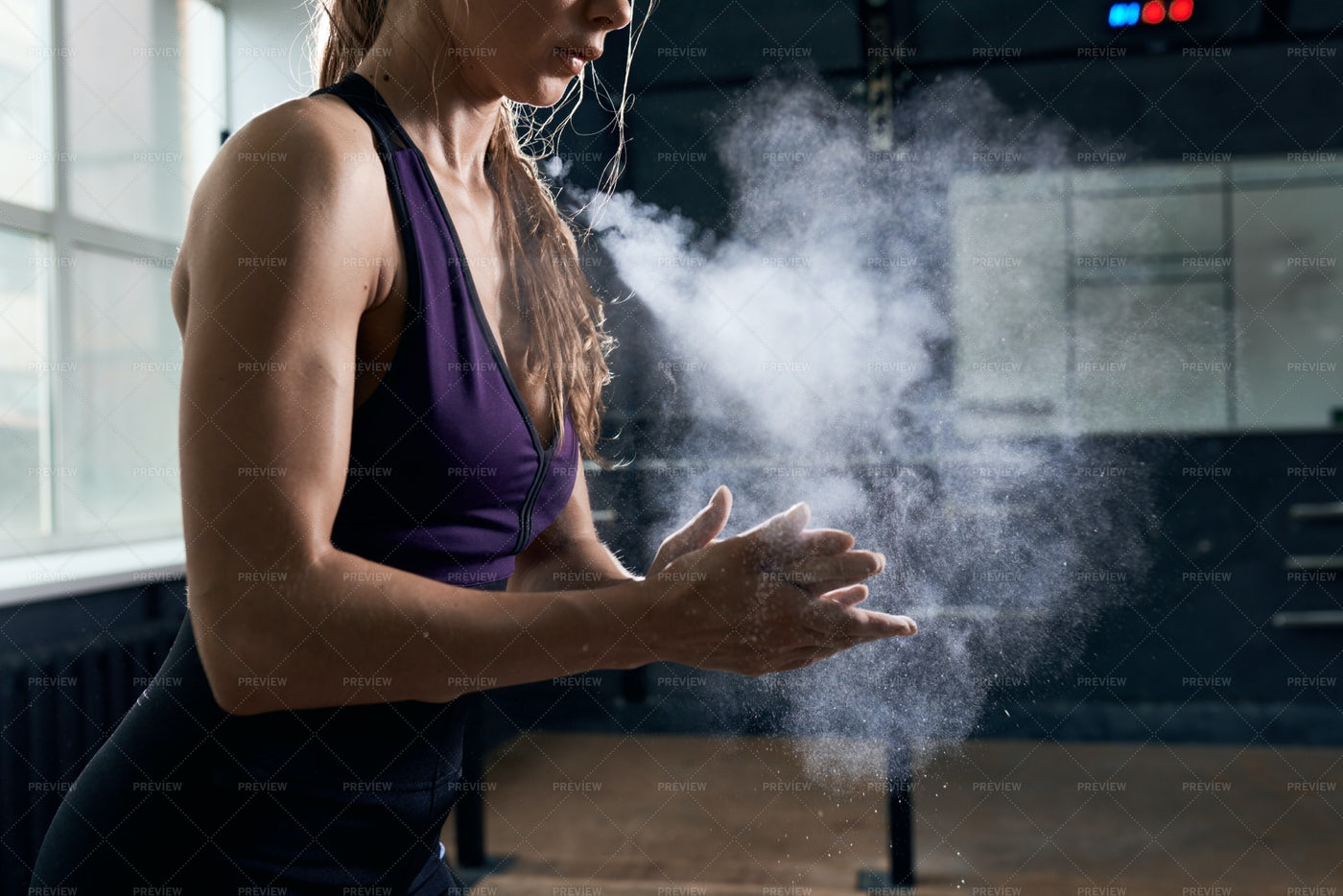 Woman Using Chalk Before Intense...: Stock Photos