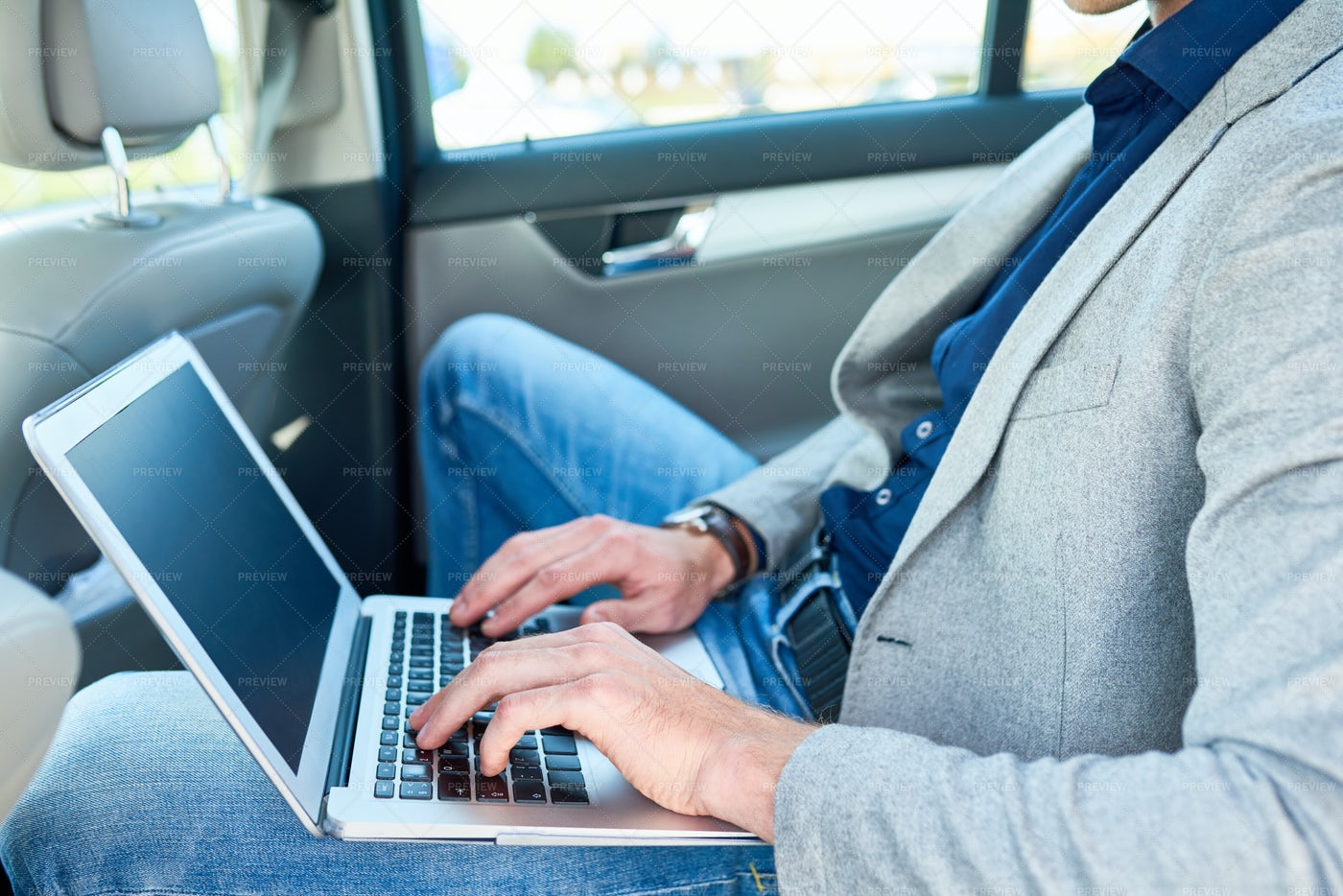 Businessman Using Laptop In Car...: Stock Photos