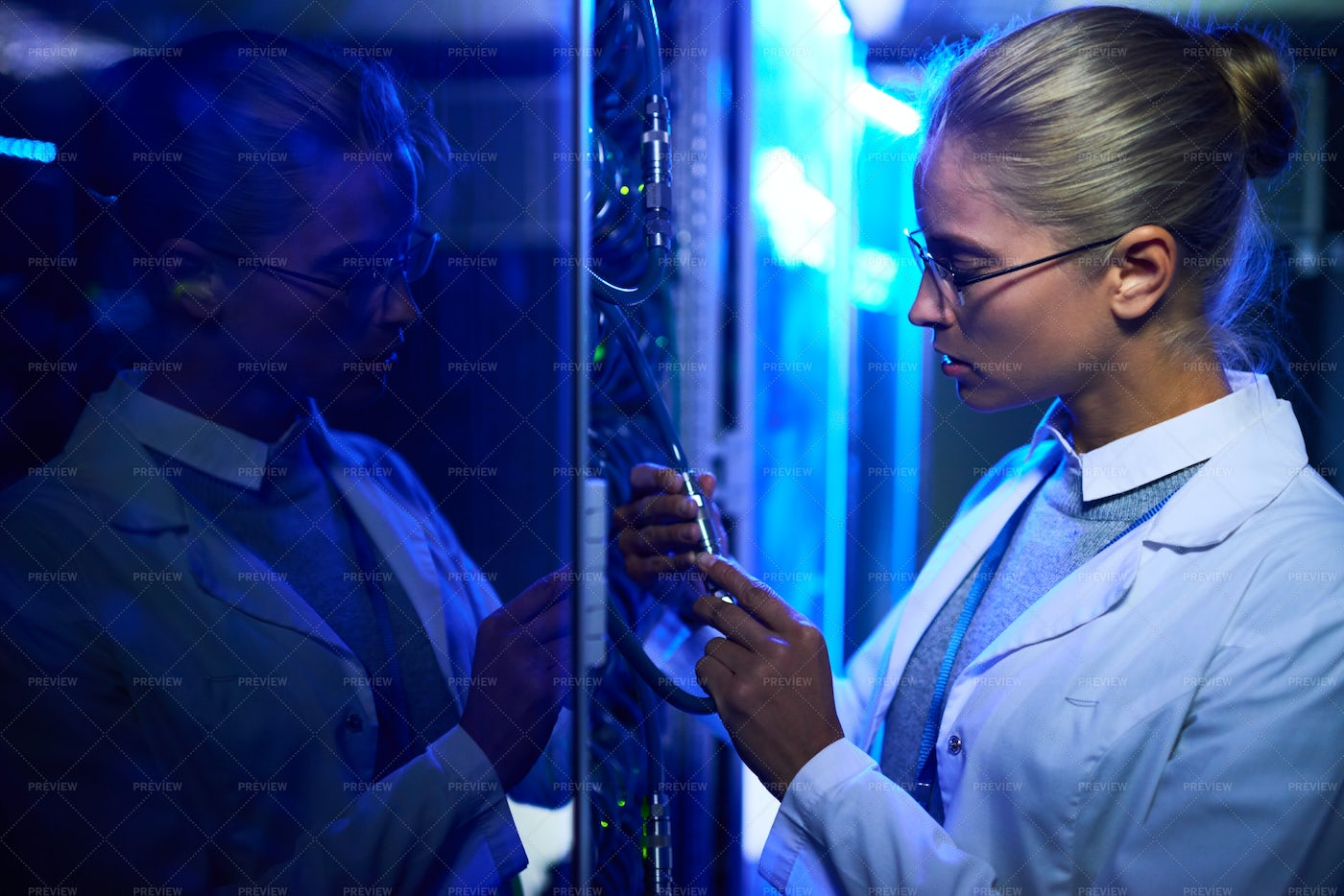 Female Scientist Working With...: Stock Photos