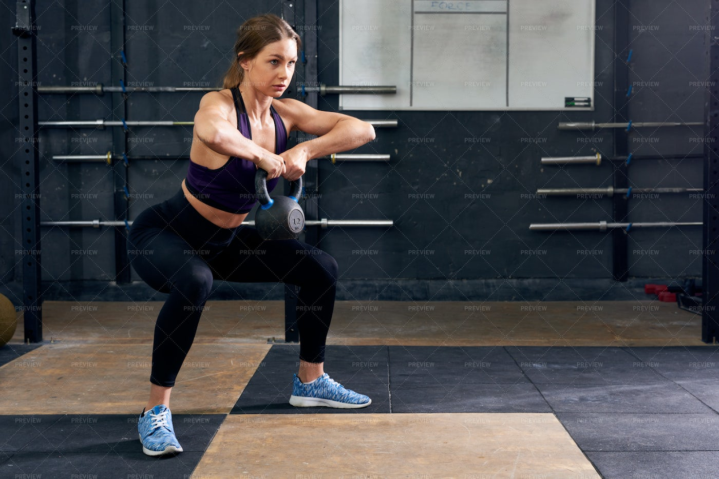 Young Woman Squatting With...: Stock Photos