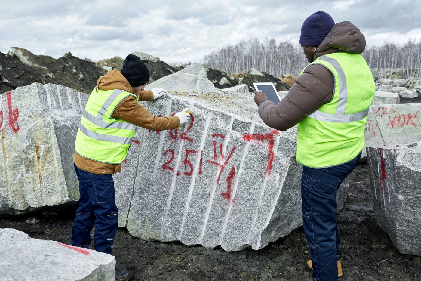 Workers Marking Granite Blocks: Stock Photos