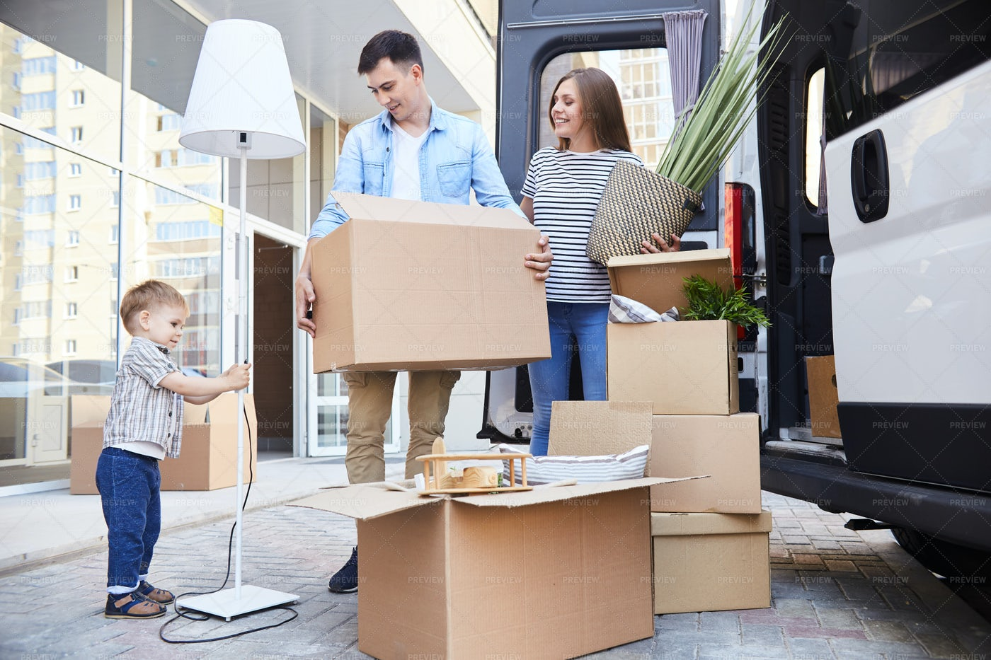 Loving   Family Moving In: Stock Photos