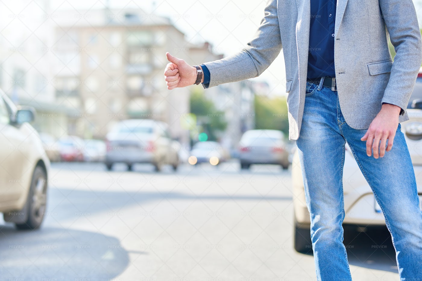 Unrecognizable Man Catching Taxi In...: Stock Photos