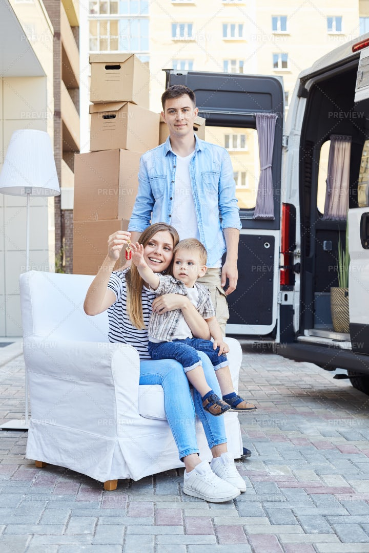 Happy Family Moving To New Home: Stock Photos