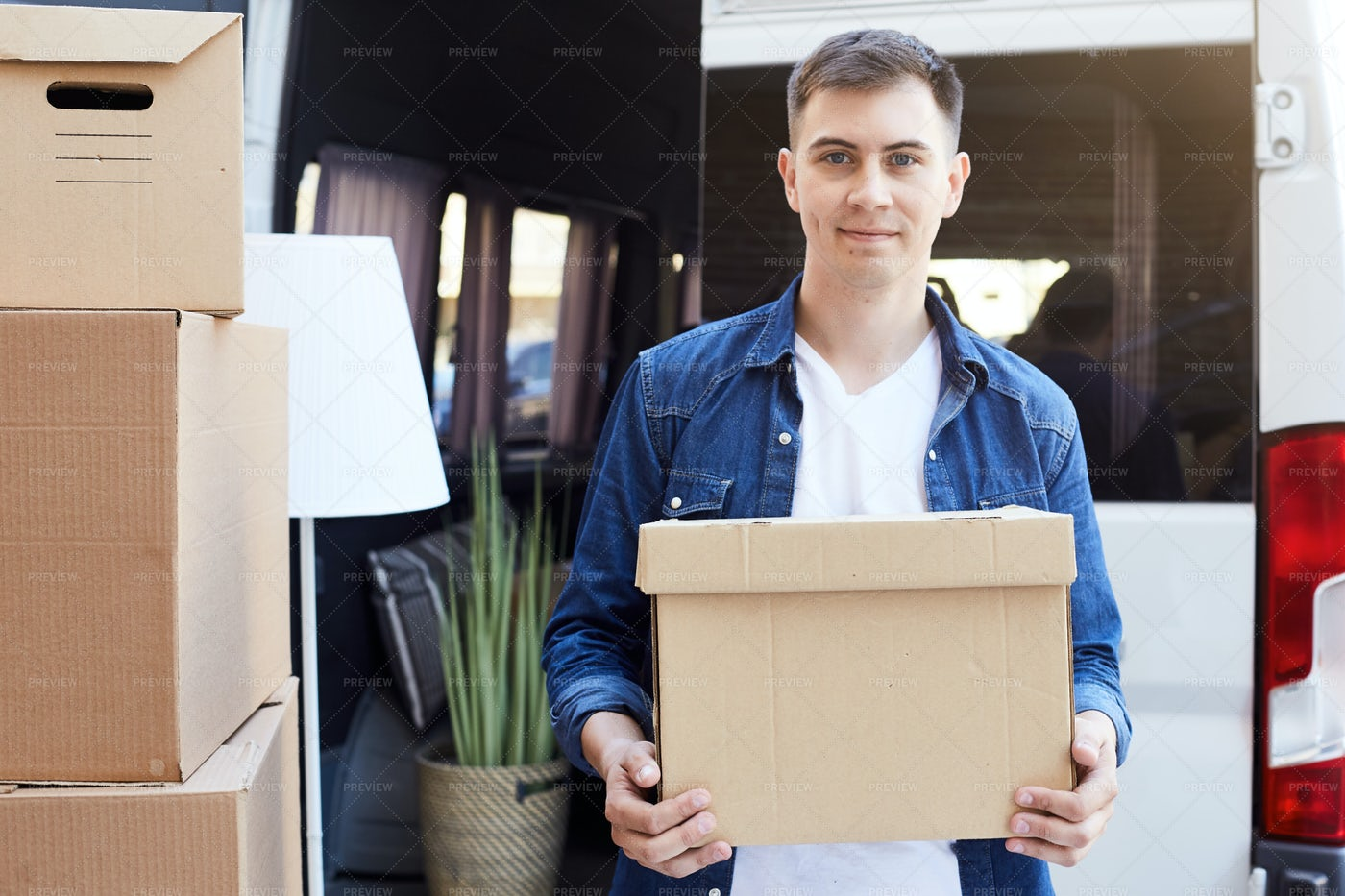 Young Man Moving In: Stock Photos