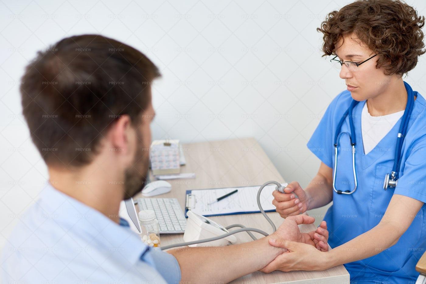 Nurse Measuring Blood Pressure For...: Stock Photos