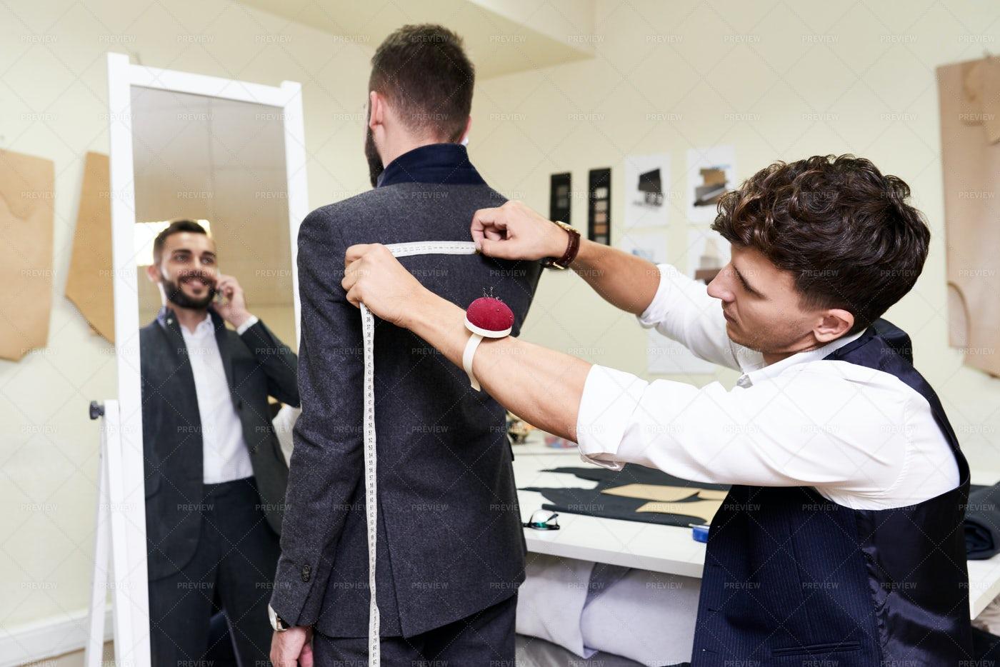 Measuring Customer At Sewing...: Stock Photos