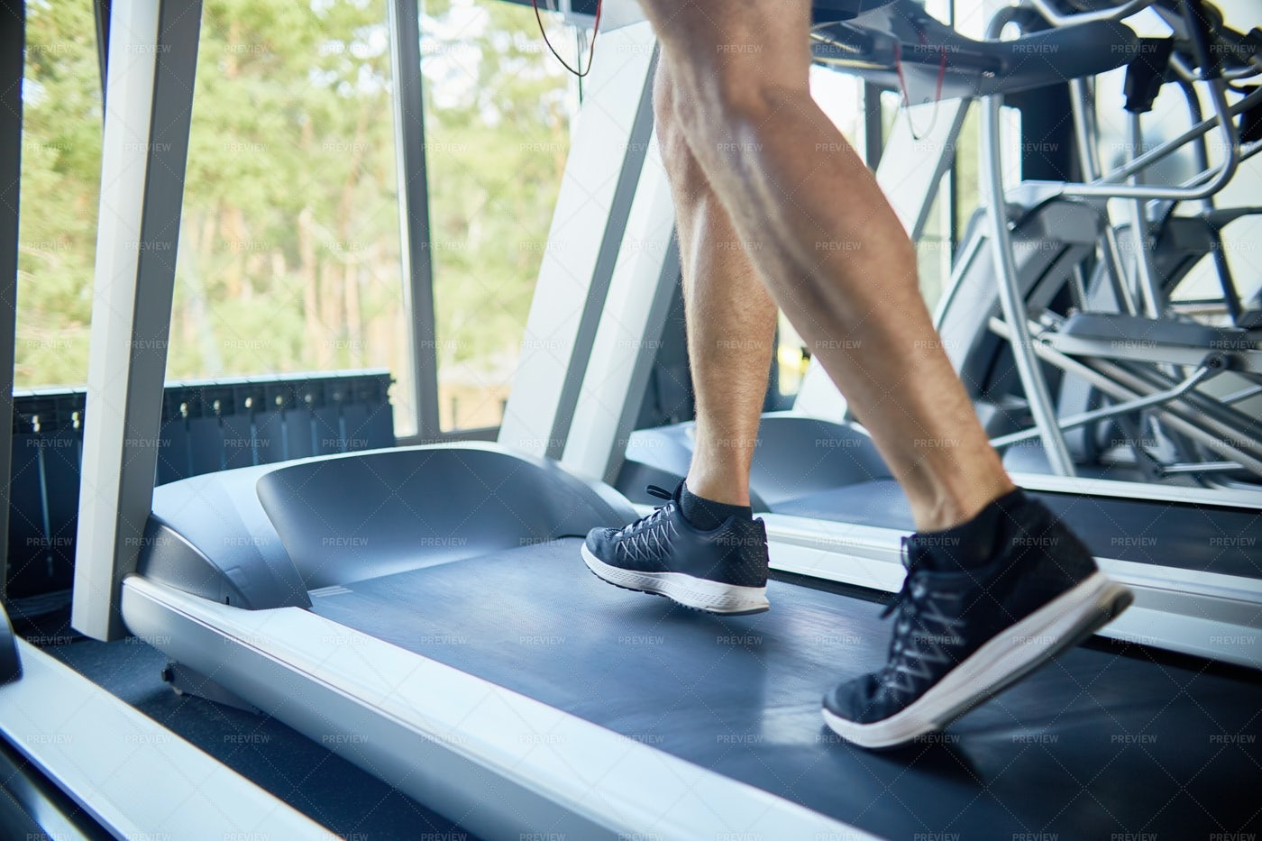 Sporty Man Running On Treadmill: Stock Photos