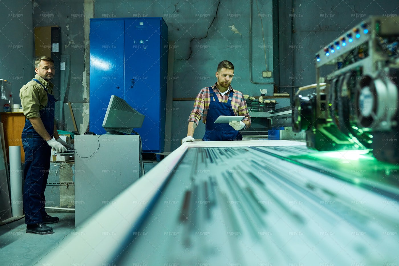 Workers Operating Laser Engraving...: Stock Photos