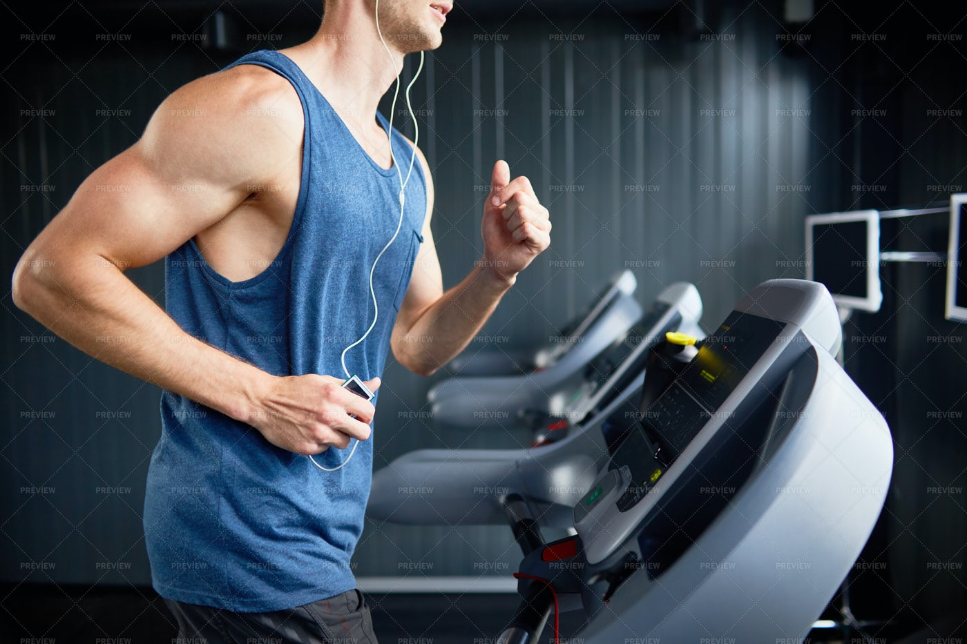 Intensive Workout At Modern Gym: Stock Photos