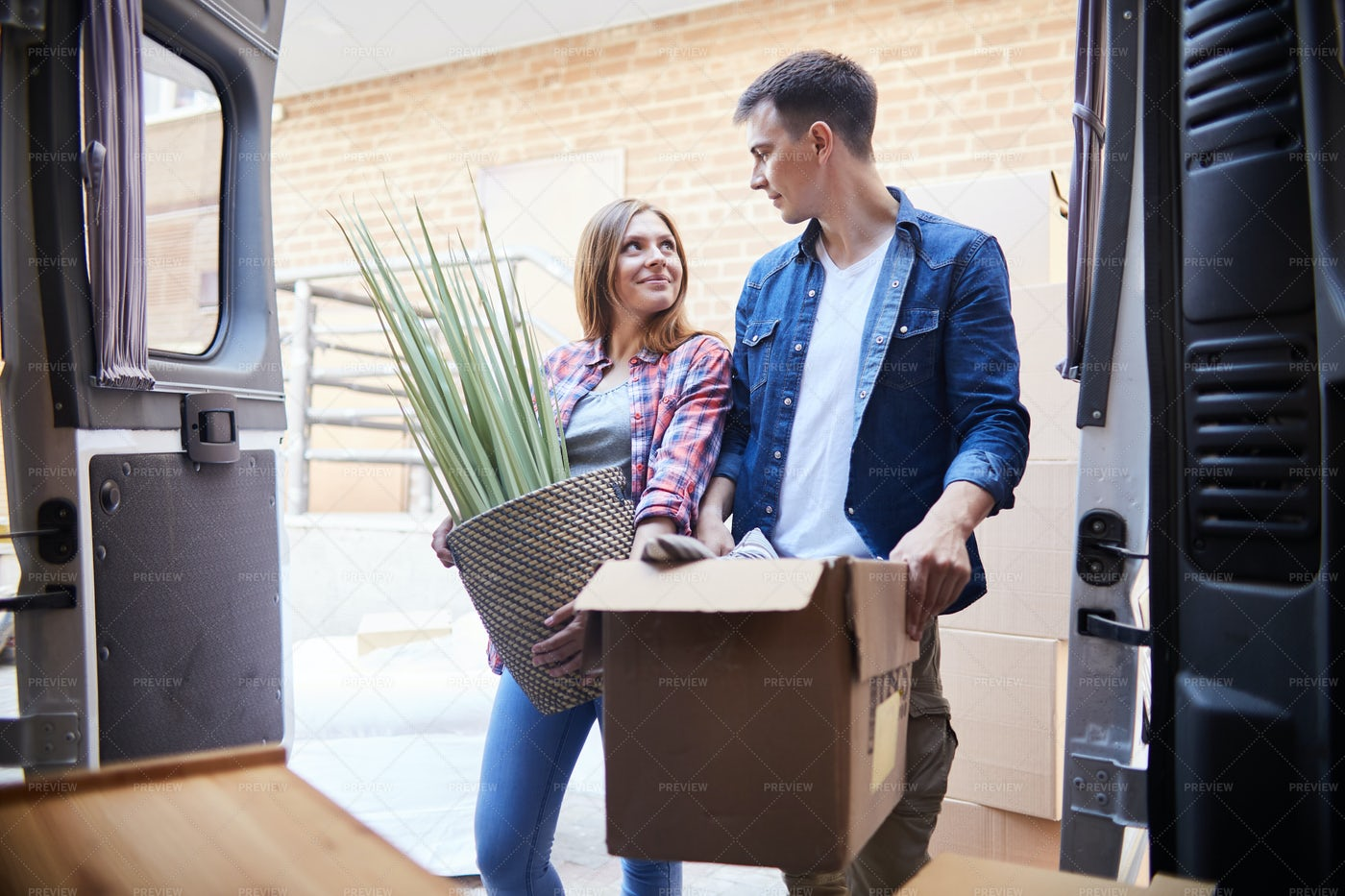 Joyful Young Couple Moving In: Stock Photos
