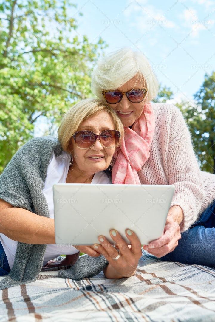Senior Women Using Laptop In Park: Stock Photos