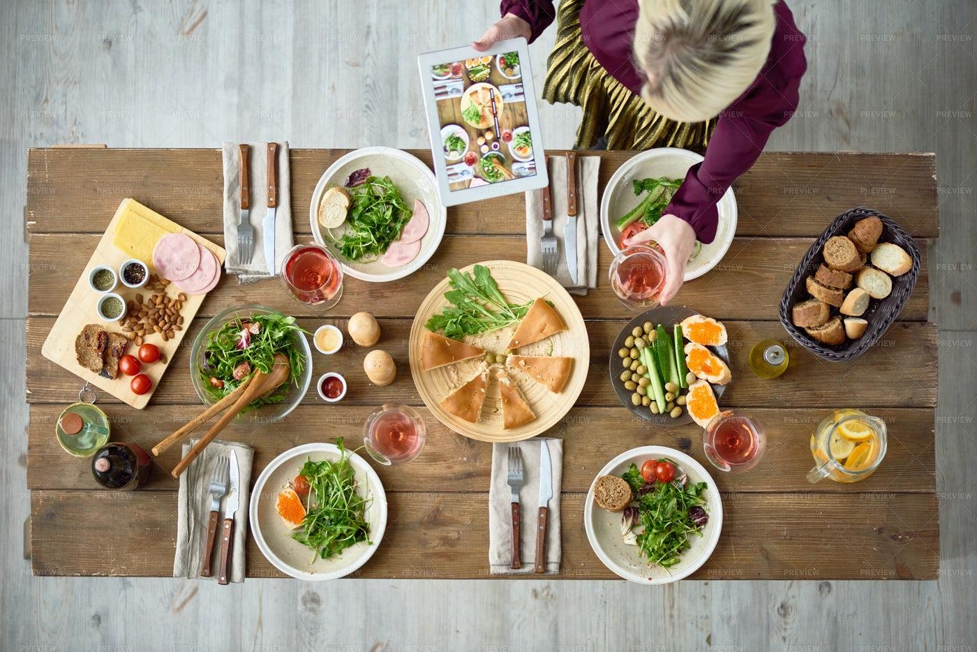 Festive Dinner Table With Food: Stock Photos