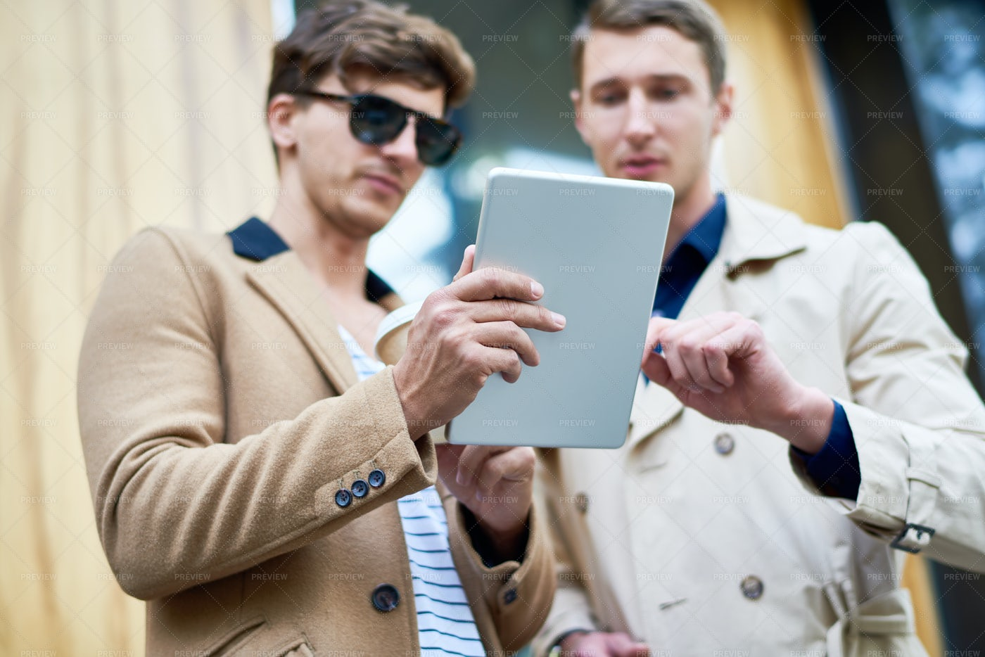 Two Business People Using Tablet In...: Stock Photos