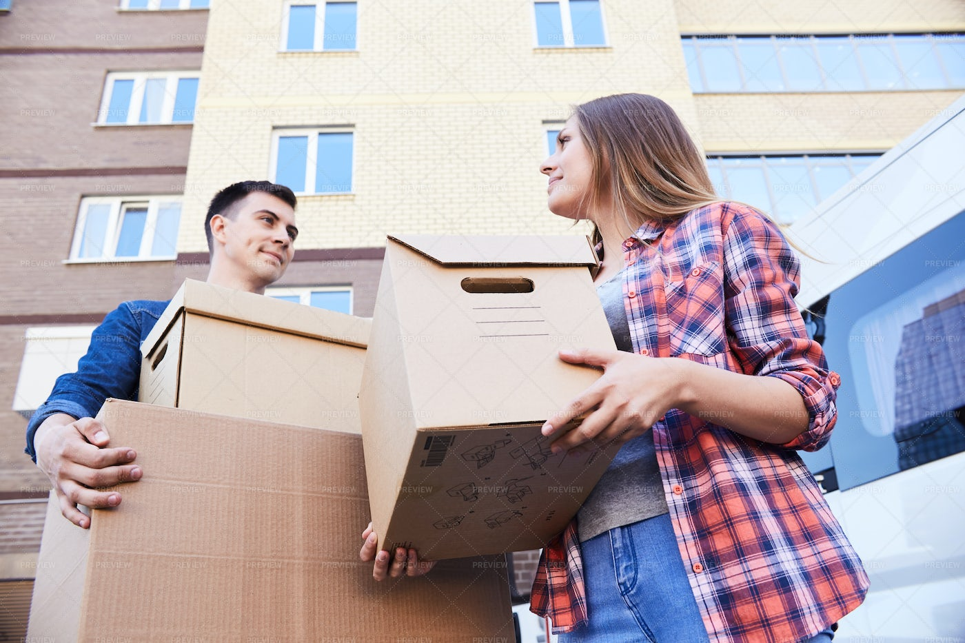 Couple Holding Boxes While Moving: Stock Photos