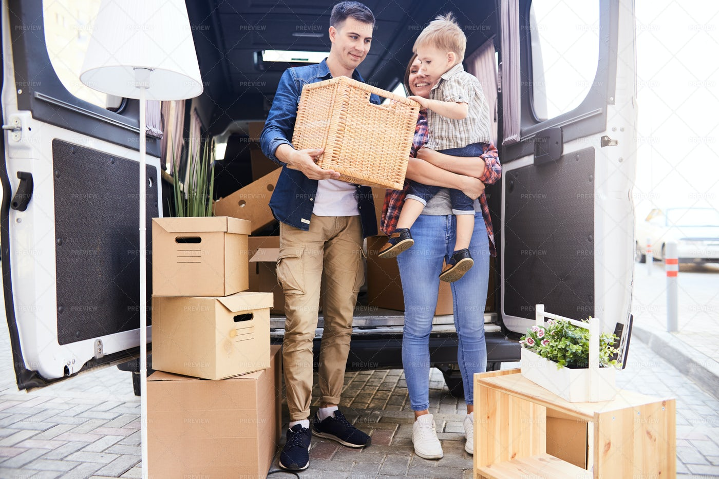 Happy Young Family Moving In: Stock Photos