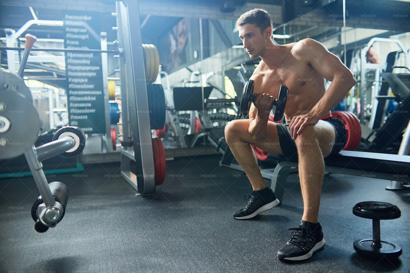 Intensive Training With Dumbbells: Stock Photos