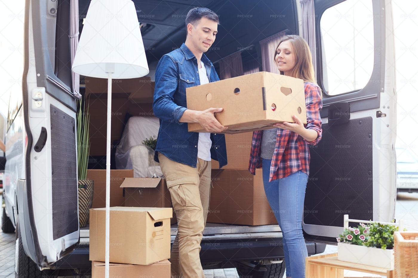 Young Couple Unloading Van: Stock Photos