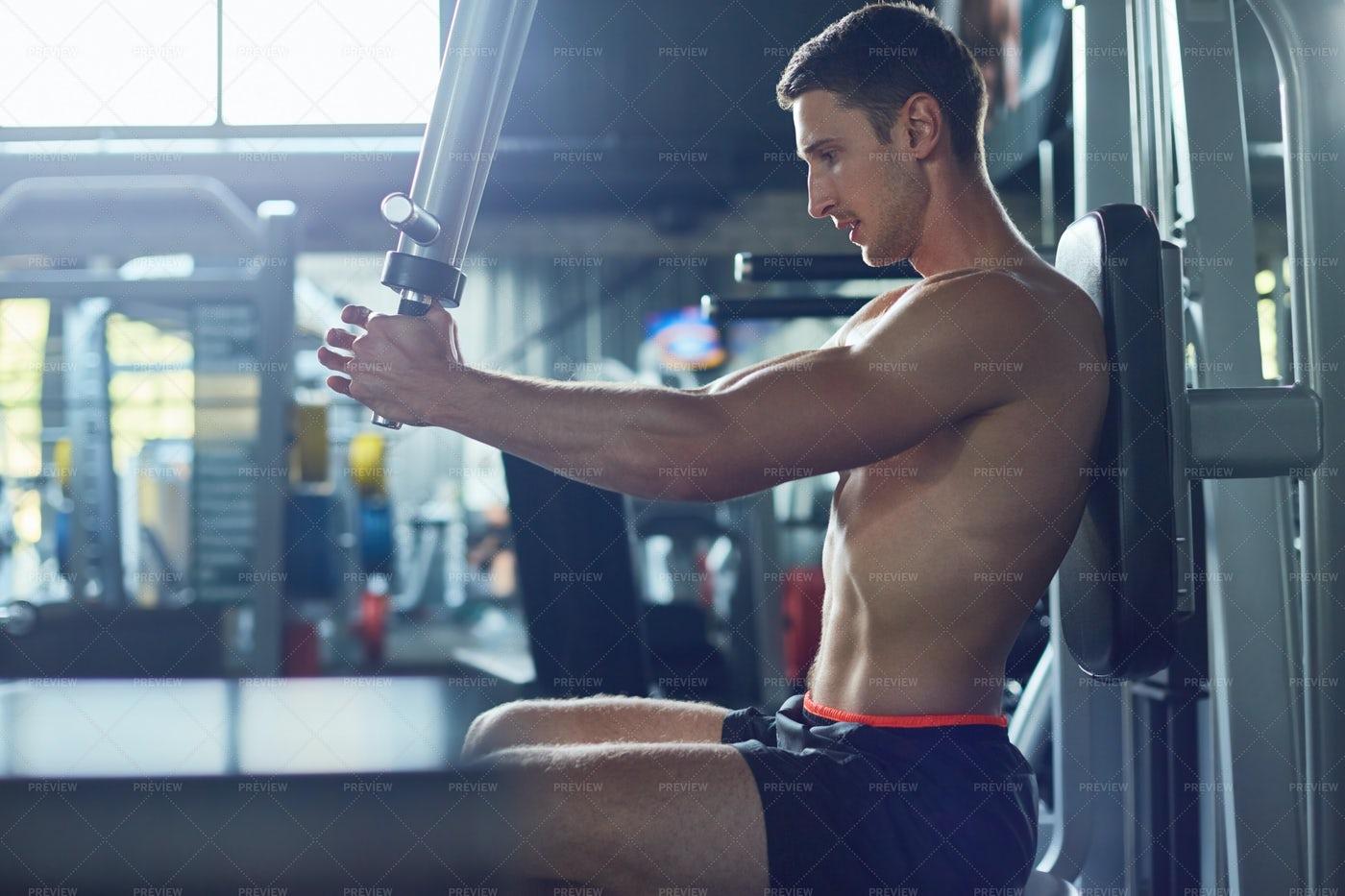 Training Upper Body At Gym: Stock Photos