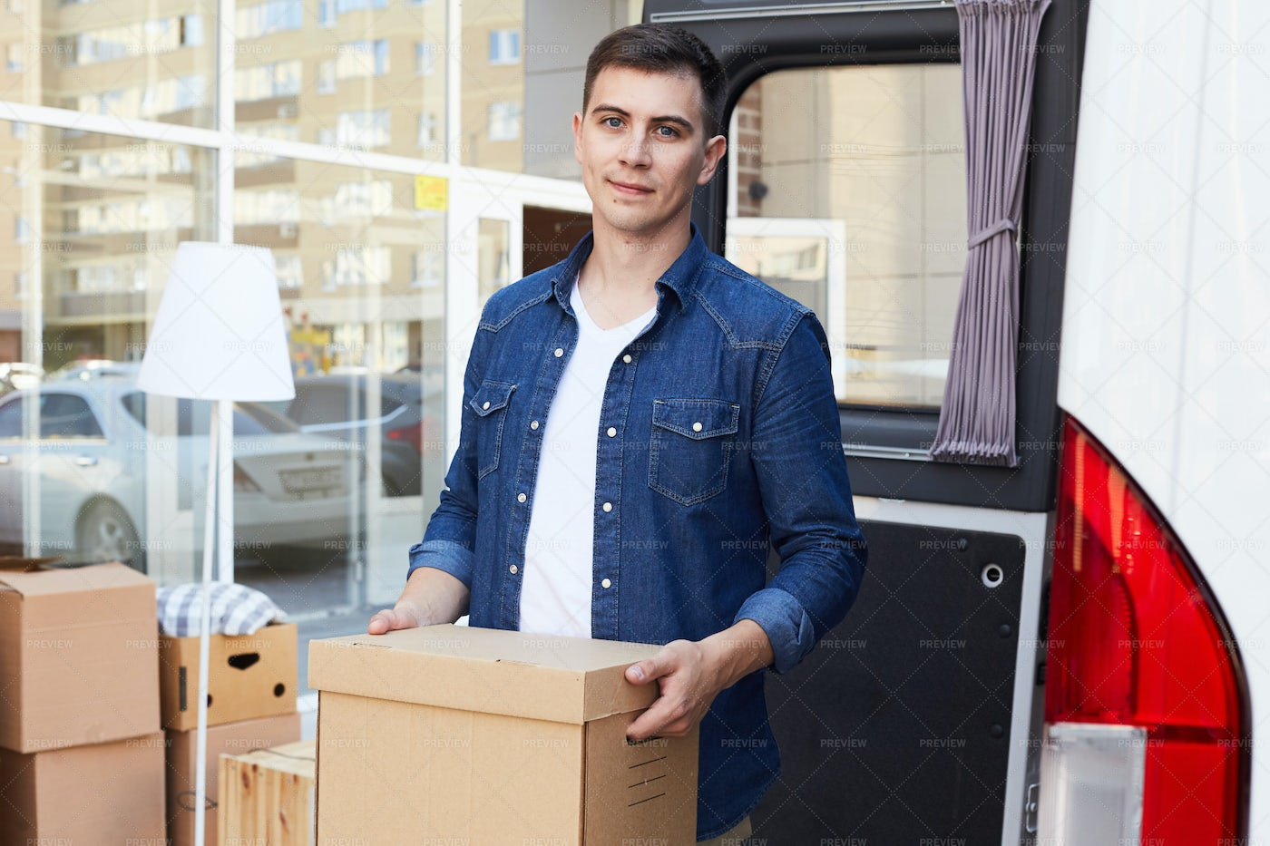Happy Man Moving House: Stock Photos