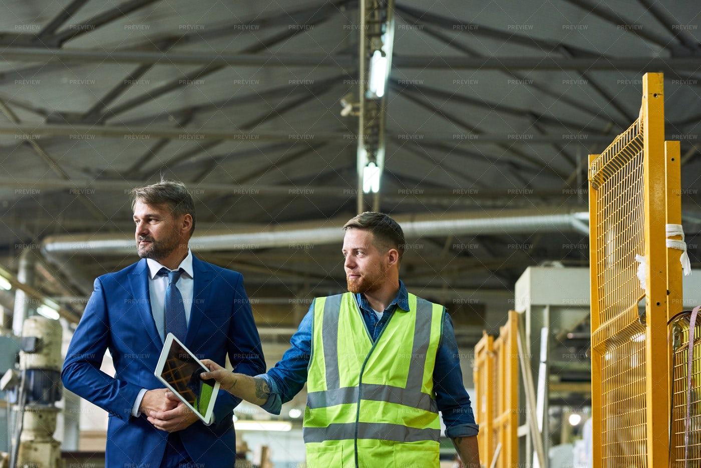 Investor Inspecting Modern Factory: Stock Photos