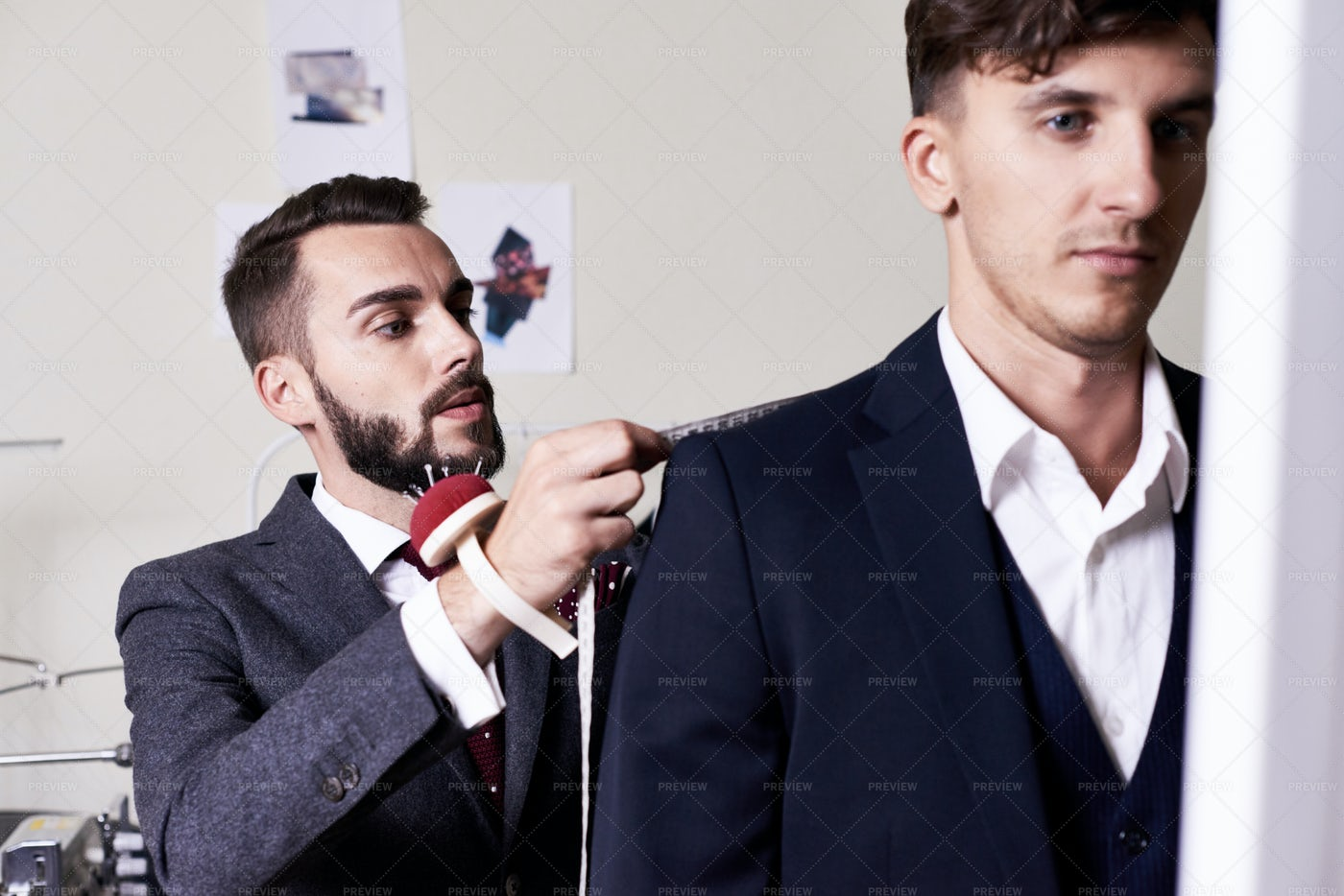 Professional Tailor Focused On Work: Stock Photos