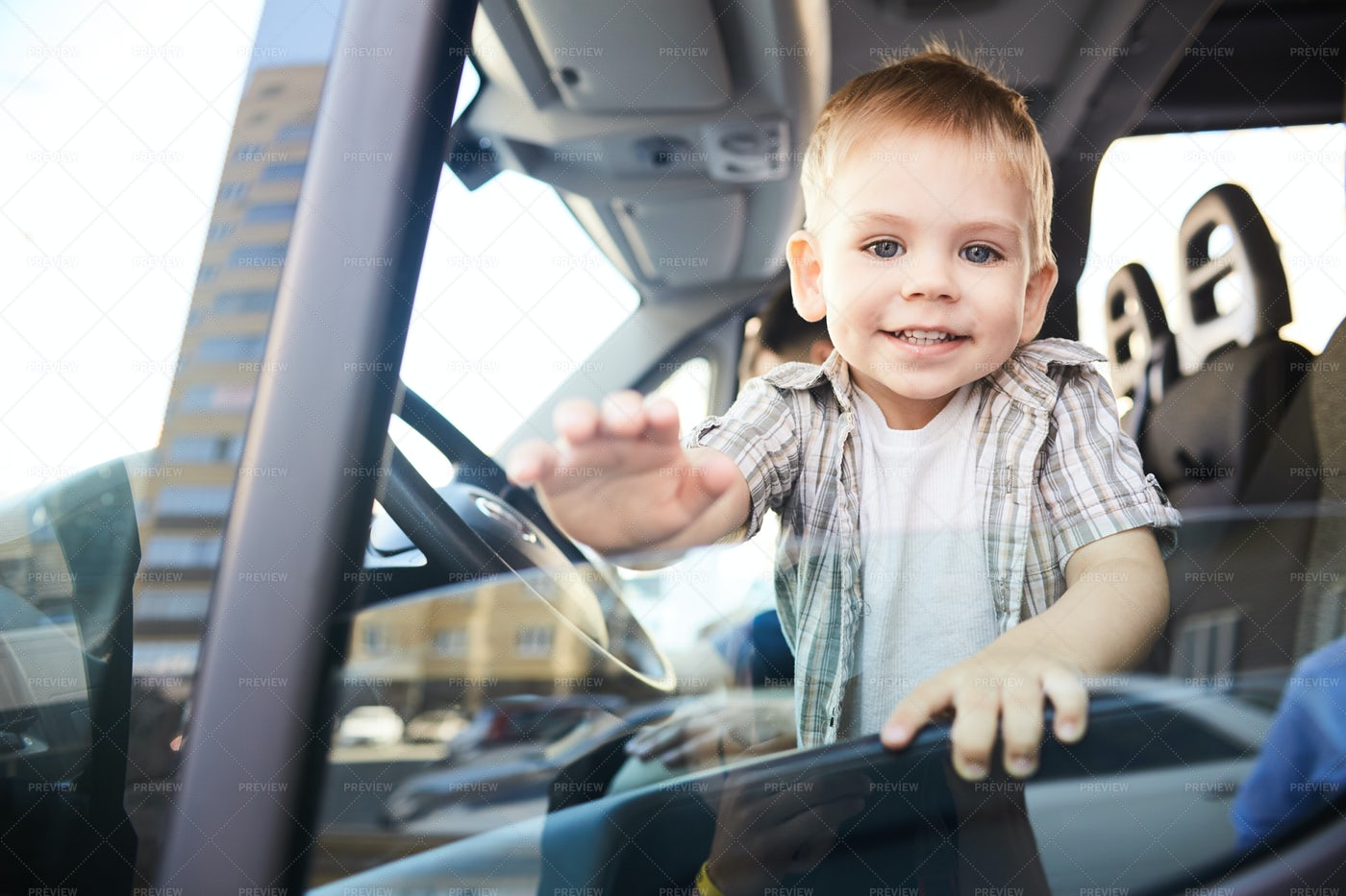 Adorable Child In Car: Stock Photos
