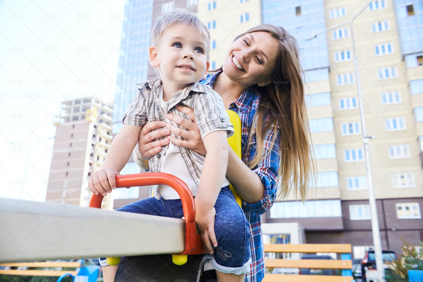 Mother And Son On Playground: Stock Photos