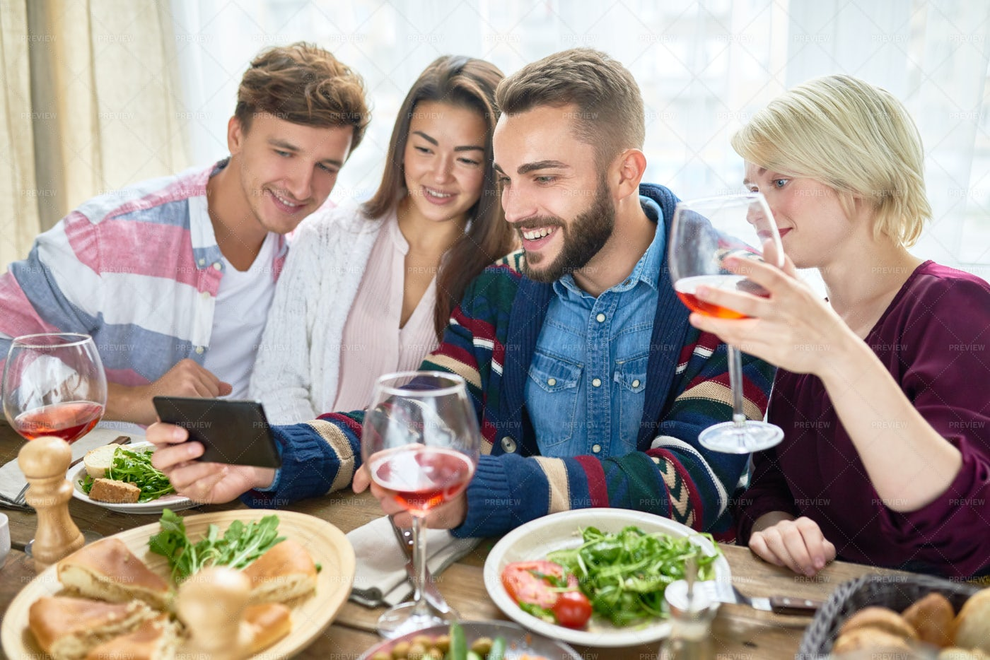 People Watching Videos At Dinner...: Stock Photos