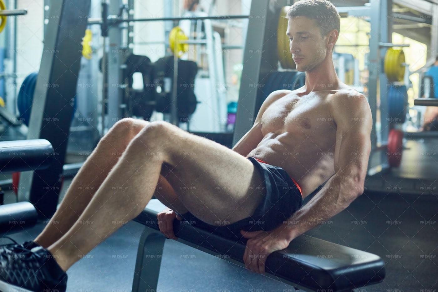 Doing Sit Ups At Gym: Stock Photos
