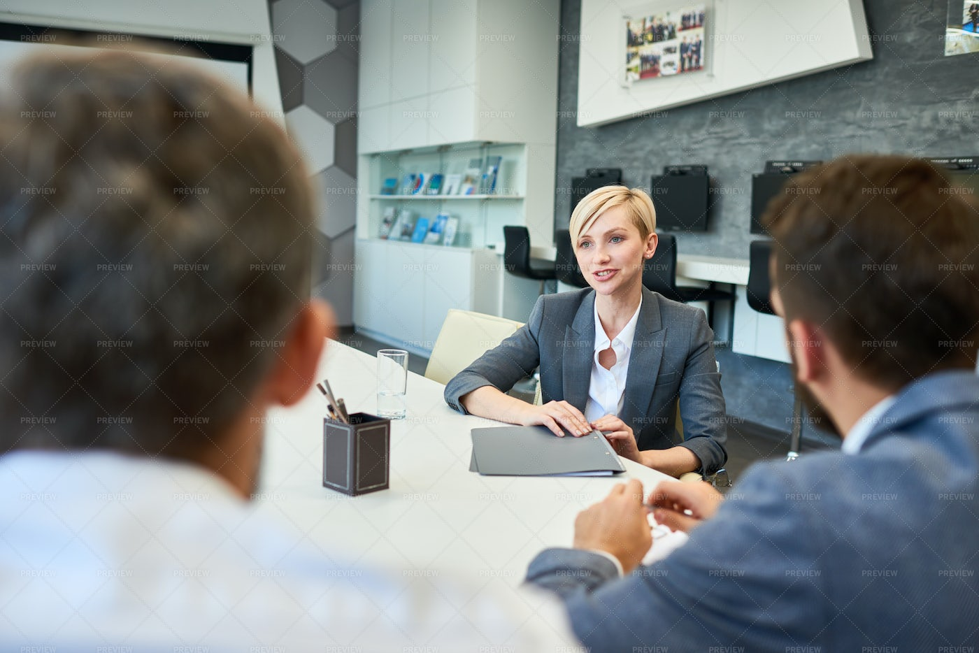 Smiling Business Woman Talking To...: Stock Photos
