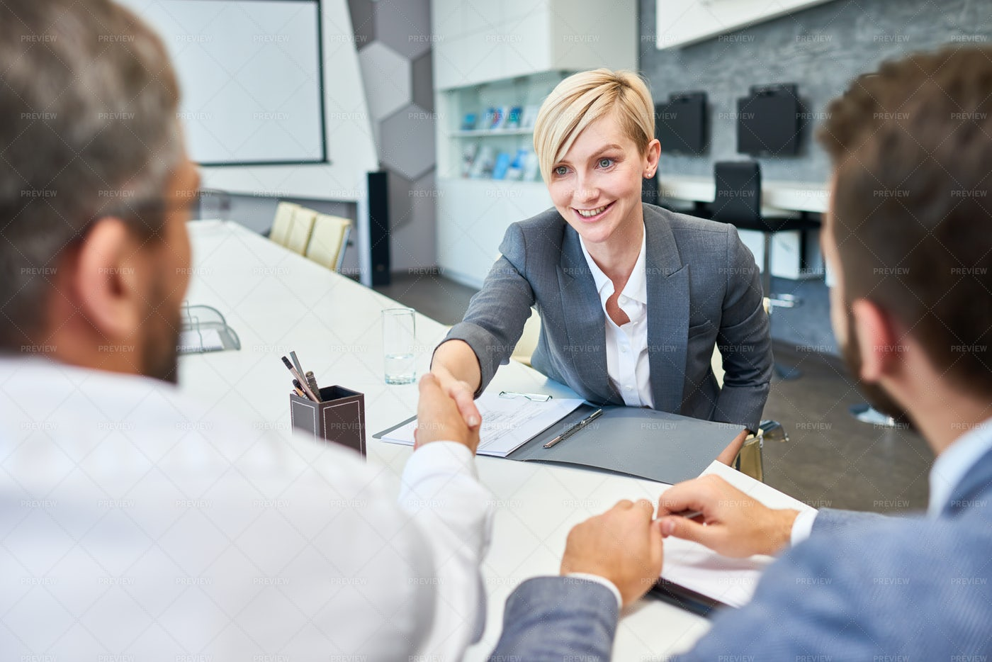 Successful Business Woman Greeting...: Stock Photos