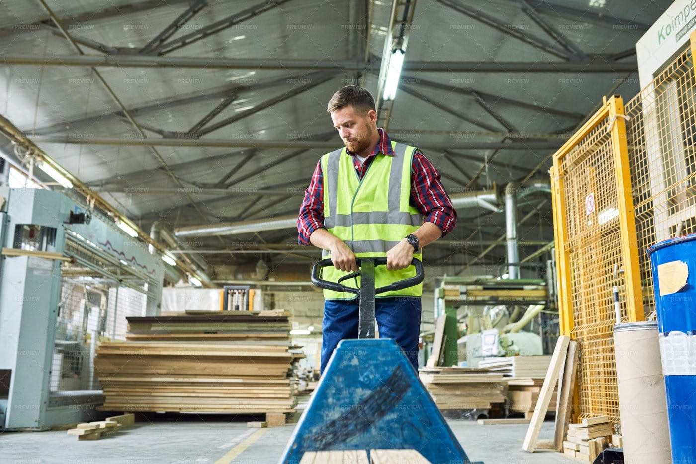 Young Man Moving Cart In Warehouse: Stock Photos