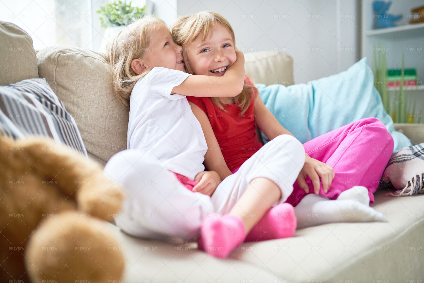 Sharing Secret With Pretty Sister: Stock Photos