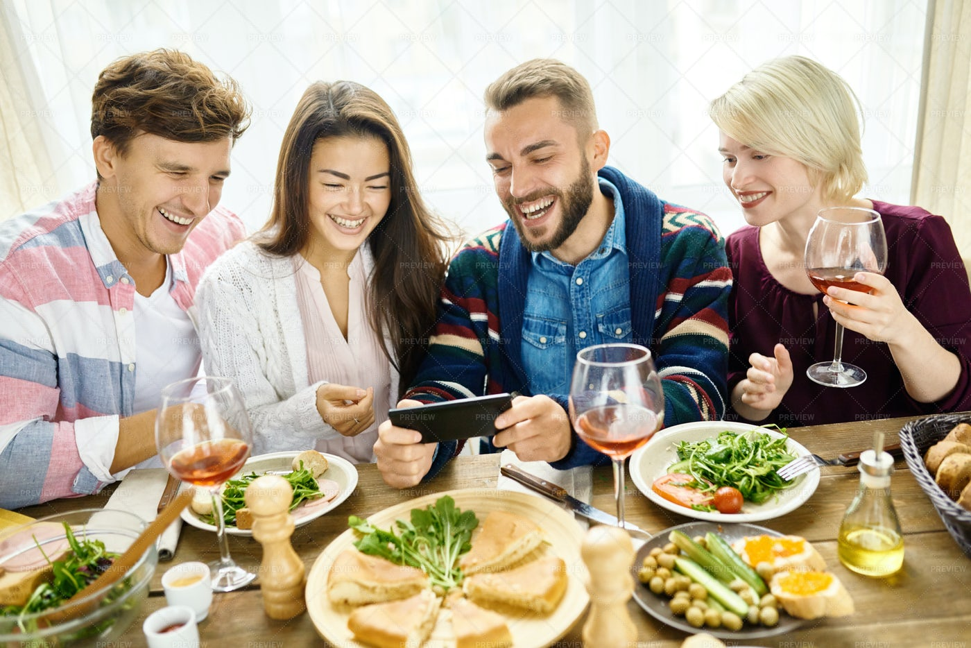 Friends Video Calling At Dinner...: Stock Photos