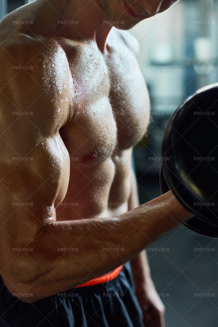 Pumping Up Muscles With Dumbbells: Stock Photos