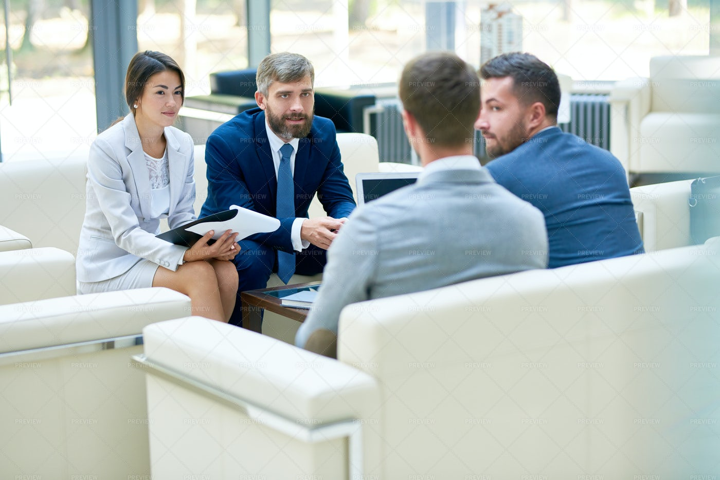 Negotiation Meeting In Office: Stock Photos
