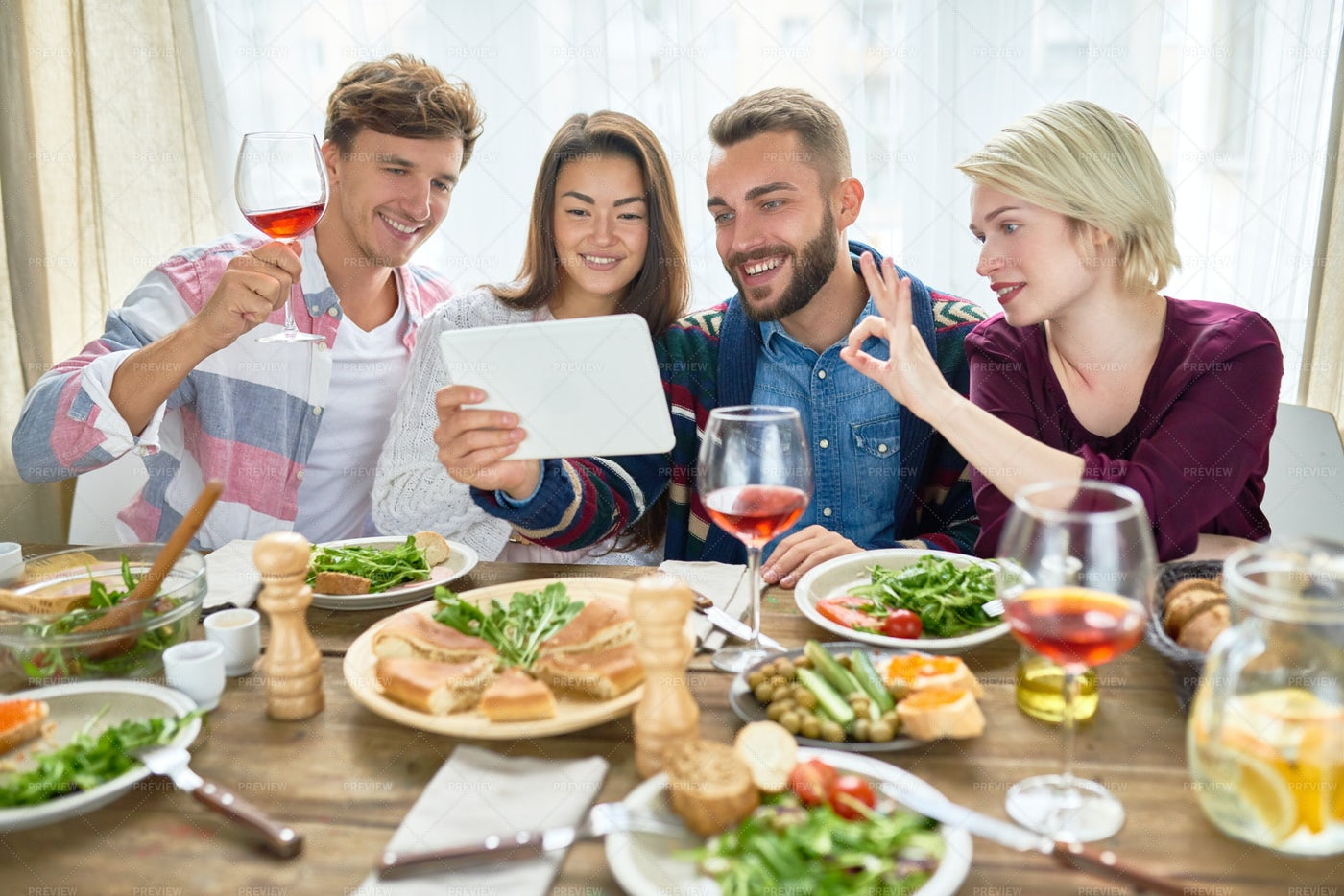 Happy Friends Video Calling At...: Stock Photos