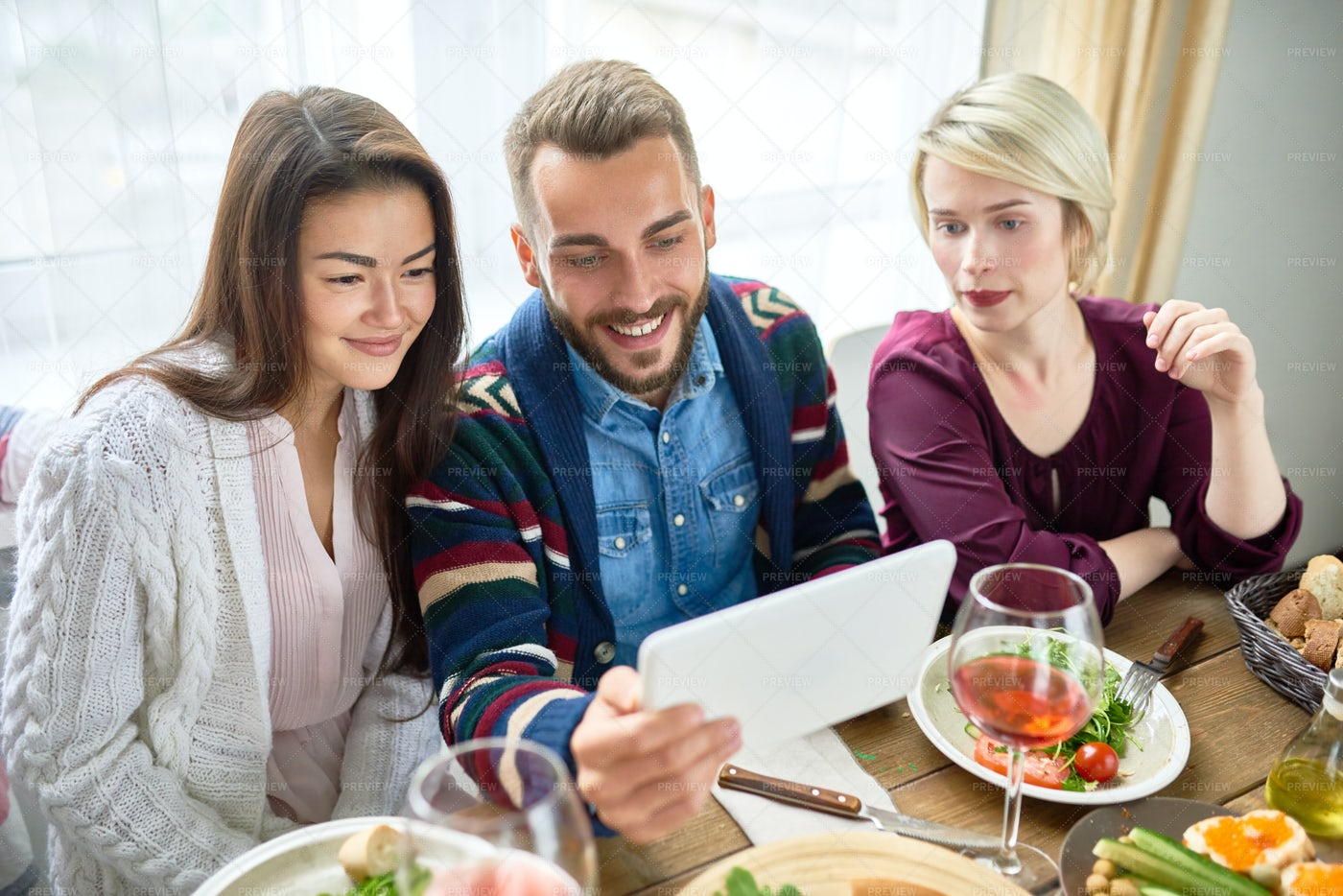 Young People Video Calling At...: Stock Photos