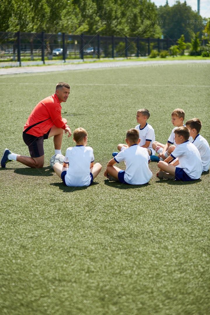 Coach Talking To Junior Football...: Stock Photos